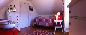 Rapunzel, the 3rd floor guest room at Bayfields Bed and Breakfast, showing off it's red and white theme.