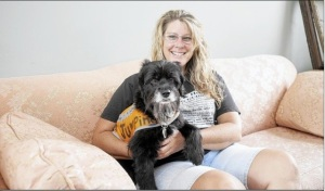 Robin Heintz Anderson, with her dog Petey, in her Home of the Week, and bed and breakfast, in Harwood.